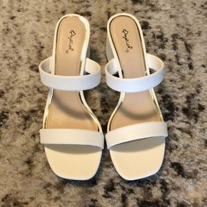 White sandals with heel. New with tags